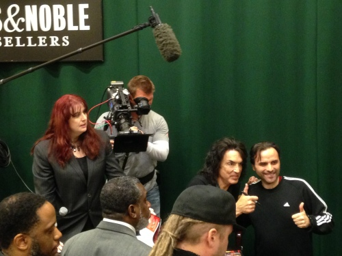 STAR GAZING - Cinematographer Kevin Simkins films KISS guitarist Paul Stanley (2nd from right) at Paul's April 7th New York City book signing for his autobiography FACE THE MUSIC: A Life Exposed.