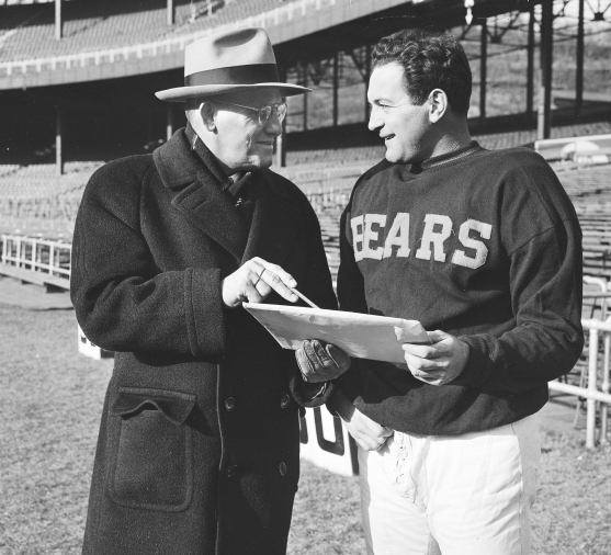 Chicago Bears' coach George Halas, left, and Sid Luckman, Bears' player, are seen at the Polo Grounds in New York, Dec. 14, 1946. (AP Photo)