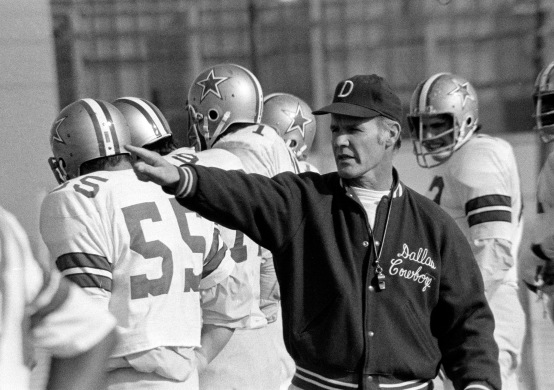 Dallas Cowboys head coach Tom Landry directs his players through a final work-out in Dallas, Texas, on Dec. 24, 1971. The Cowboys leave for Minnesota and the play-off game with the Vikings. (AP Photo)