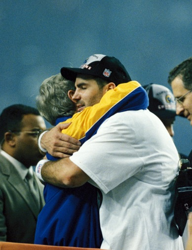 Saint Louis Rams Kurt Warner, quarterback and Super bowl MVP holds hugs Head coach Dick Vermeil after the NFL Super Bowl XXXIV against the Tennessee Titans ,played on January 30 at the Georgia Dome in Atlanta, Georgia The Rams (16–3) defeated the Titans (16–4) 23-16. (AP Photo/Tom DiPace)