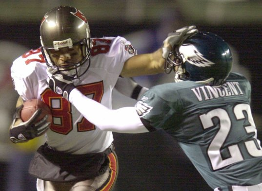 Philadelphia Eagles Troy Vincent (23) is straight-armed as he tries to tackle Tampa Bay Buccaneers receiver Keenan McCardell (87) in the third quarter during the NFC Championship game at Veterans Stadium in Philadelphia, Sunday, Jan. 19, 2003. (AP Photo/Charles Krupa)
