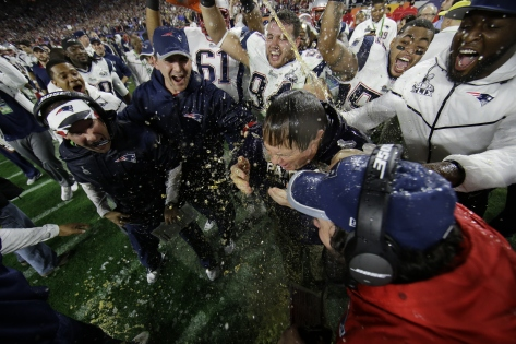New England Patriots head coach Bill Belichick is doused by sports drink after NFL Super Bowl XLIX football game against the Seattle Seahawks Sunday, Feb. 1, 2015, in Glendale, Ariz. The Patriots won 28-24. (AP Photo/Matt Slocum)
