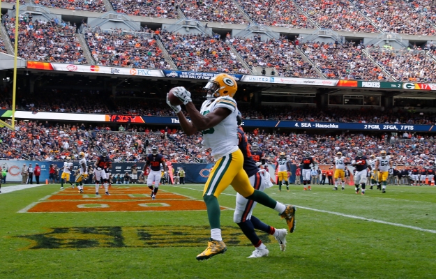 Green Bay Packers wide receiver Randall Cobb (18) makes a touchdown reception against Chicago Bears cornerback Sherrick McManis (27) during the second half an NFL football game, Sunday, Sept. 13, 2015, in Chicago. (AP Photo/Charles Rex Arbogast)