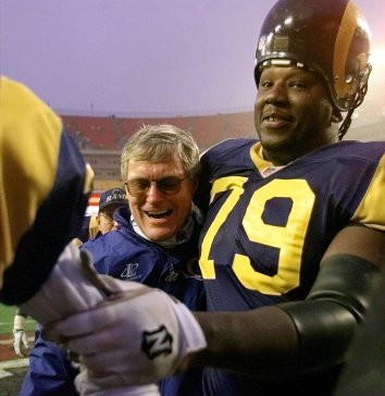 St. Louis Rams coach Dick Vermeil gets a victory hug from defensive end Bill Johnson (79) after his team beat the Washington Redskins 23-20 in the final seconds of the game at Jack Kent Cooke Stadium in Landover, Md. Sunday Nov. 30, 1997. (AP Photo/Susan Walsh)