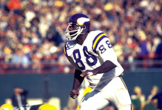Defensive tackle Alan Page of the Minnesota Vikings heads upfield after the ball in a 1970 game. (AP Photo/Vernon Biever)