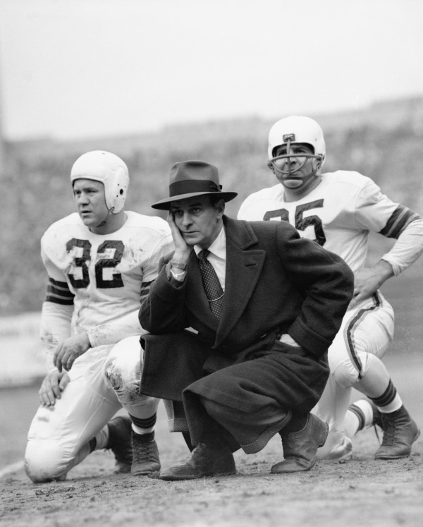 Original caption: Paul Brown, Cleveland's pro coach with players. (Copyright Bettmann/Corbis / AP Images)