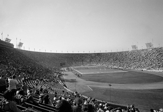 Few of the 61,946 fans attending the First AFL-NFL World Championship Game — now known as Super Bowl I — on Jan. 15, 1967, could have known they were witnessing the birth of an American institution. With ticket prices topping out at all of $12, Los Angeles Coliseum was only about two-thirds full as the NFL's Green Bay Packers, led by quarterback Bart Starr, defeated the AFL's Kansas City Chiefs 35-10. (AP Photo)